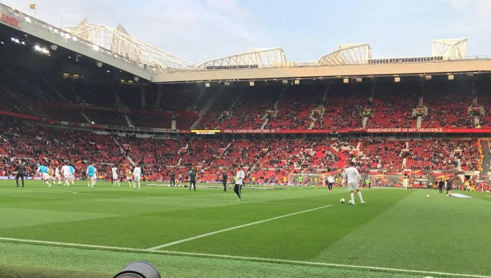 Old Trafford,  Section <strong>X</strong>, Row <strong>7</strong>