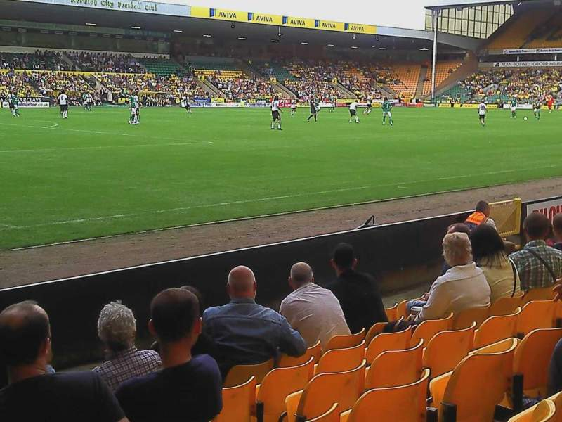 Carrow Road, section: Community stand lower tier, row: G, seat: 240
